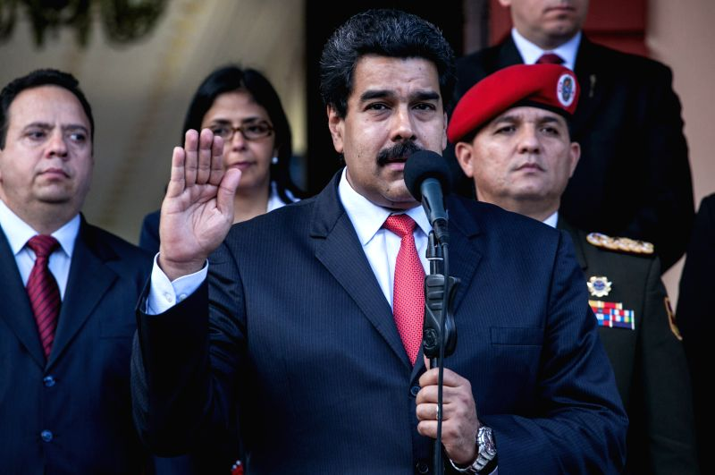 Venezuelan President Nicolas Maduro (Front) speaks to media after his meeting with Paraguayan President Horacio Cartes at the Miraflores presidential Palace in ...