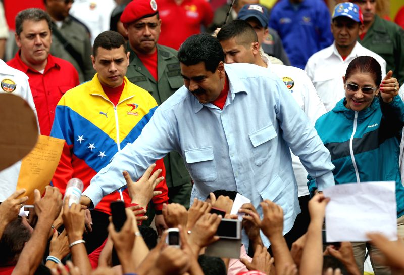 CARACAS, June 1, 2016 - Venezuela's President Nicolas Maduro greets people during a demonstration to support his government in Caracas, Venezuela, on May 31, 2016.