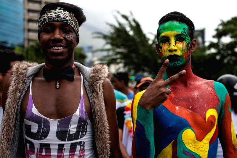People participate in the Gay Pride Parade, in Caracas, Venezuela, on June 29, 2014.