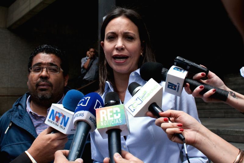 Former opposition legislator Maria Corina Machado talks to media as she arrives to the Venezuela's Central Bank (BCV) headquarters in Caracas, Venezuela, on March ...