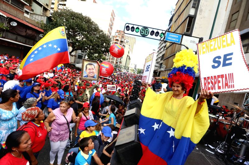 Residents take part in a demonstration against the recent sanctions of the U.S. Government against Venezuela, in Caracas, Venezuela, on March. 15, 2015. ...