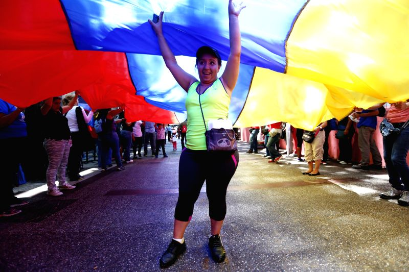A woman takes part in a workers education march to protest recent U.S. measures against Venezuelan government, in Caracas, Venezuela, on March 22, 2015. Venezuelan ...