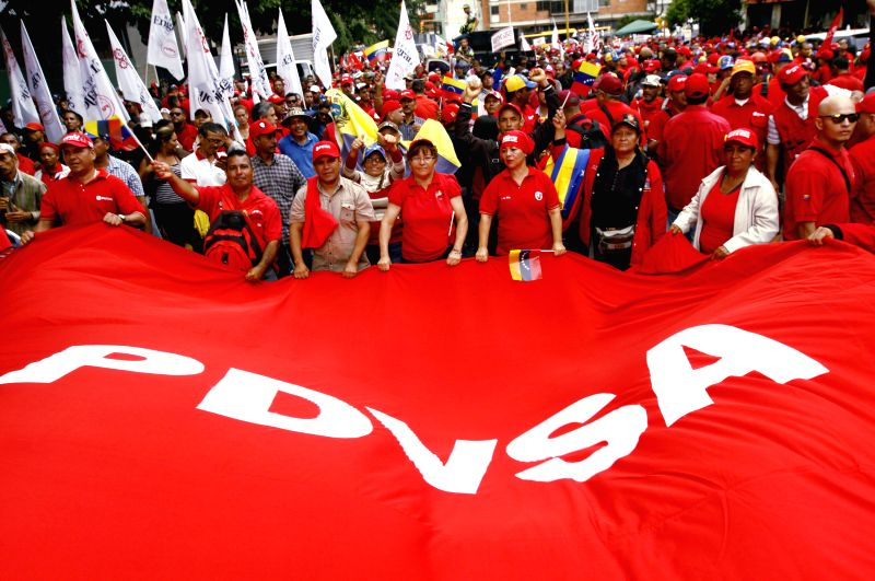 CARACAS, May 1, 2017 - Venezuelan oil sector workers and government supporters hold a banner of Petroleum of Venezuela (PDVSA) during a march to commemorate the International Labor Day in Caracas, ...
