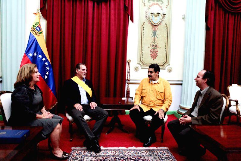 Cuban social fighter, Rene Gonzalez (2nd L) meets with Venezuelan President, Nicolas Maduro (2nd R) after receiving the Francisco de Miranda Order at Miraflores ...
