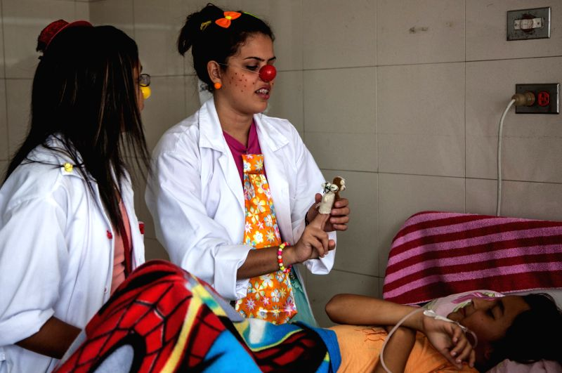 "Volunteers from the organization ""Doctor Yaso Hospital Clowns"", dressed up as clowns, take part in an activity held at the Doctor Jose Manuel de los Rios .."