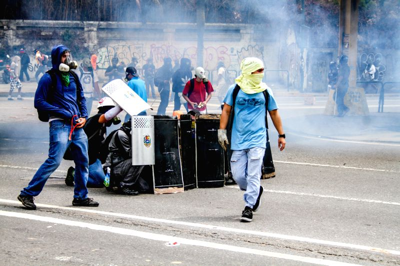 Demonstrators clash with security force members after a protest in the Mercedes, Caracas, Venezuela, May 12, 2014. According to local press, the protest was held to .