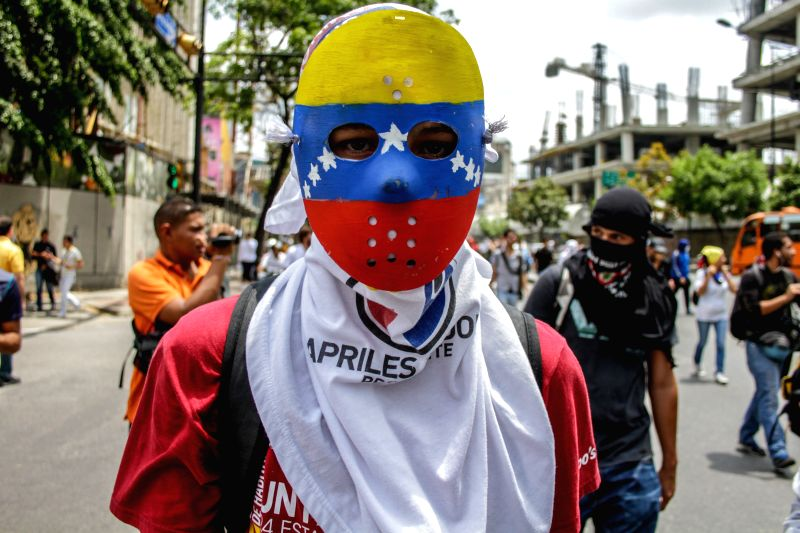 A demonstrator is seen during a protest in Los Palos Grandes, Caracas, Venezuela, on May 14, 2014. The demonstrators demanded the release of the protestors arrested .