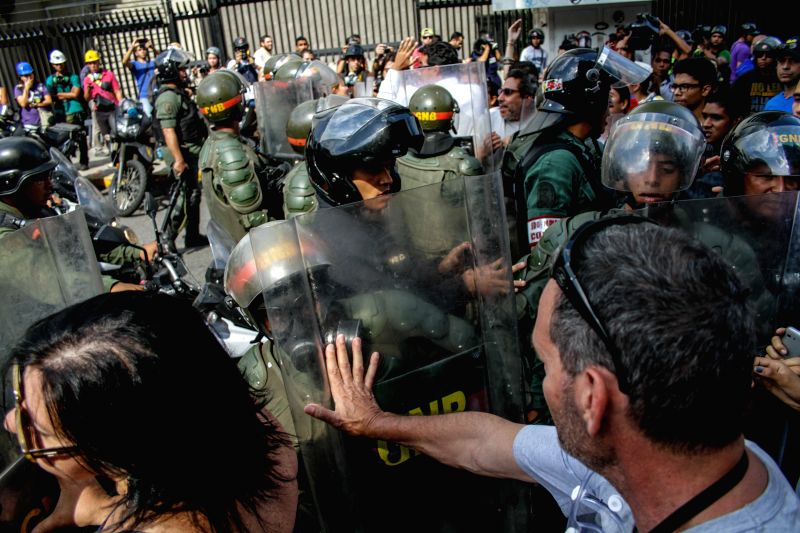 Demonstrators are blocked by members of the Bolivarian National Guard during a protest in Los Palos Grandes, Caracas, Venezuela, on May 14, 2014. The demonstrators ..