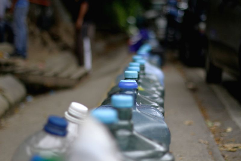 CARACAS, May 18, 2016 - People wait to fill jugs with water in Caracas, capital of Venezuela, on May 17, 2016. According to local press, the Guri dam, the most important generator of hydroelectricity ...