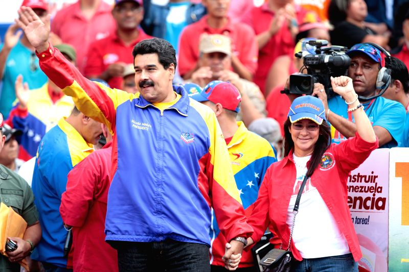 Photo provided by the Venezuelan Presidency shows Venezuelan President Nicolas Maduro (L) taking part in a march to commemorate the International Labor Day, in ...