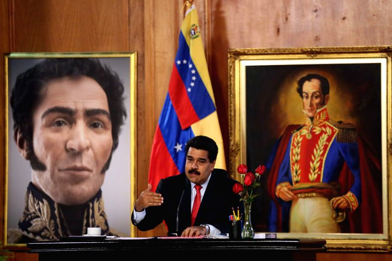 Venezuelan President Nicolas Maduro takes part in a radio and TV national broadcast, where he makes announcements of national interest, in Miraflores Palace in ...