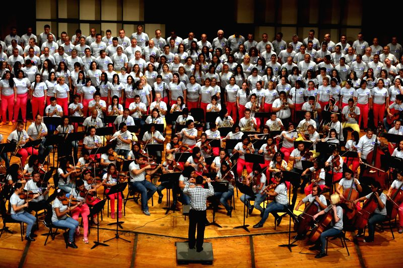 Caracas (Venezuela): Members of the Penitentiary Symphonic Orchestra take part in a Christmas concert for the Peace, in the Teresa Carreno Theater, in Caracas, Venezuela, on Dec. 7, 2014. ...