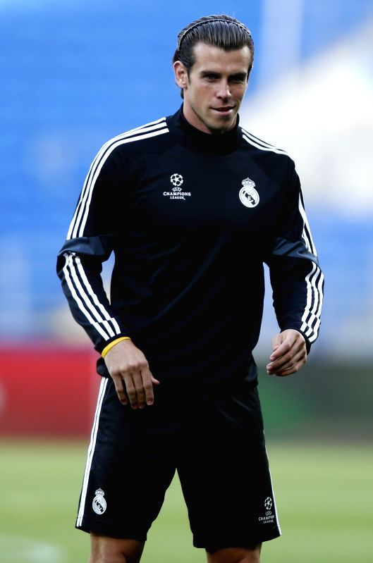 Gareth Bale of Real Madrid takes a training session for the UEFA Super Cup match between Real Madrid and Sevilla at Cardiff City Stadium in Cardiff, Britain on Aug. .