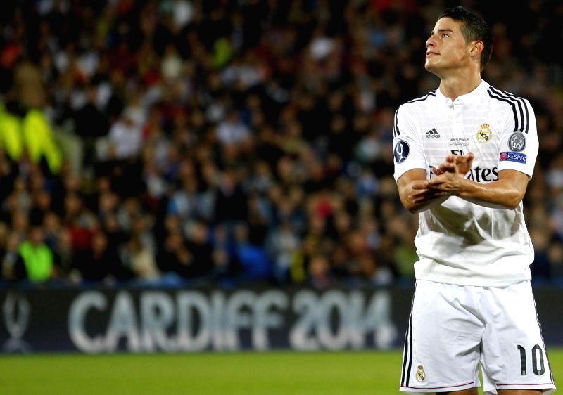 Real Madrid's James Rodriguez reacts after missing a goal during the UEFA Super Cup match between Real Madrid and Sevilla at Cardiff City Stadium in Cardiff, ...