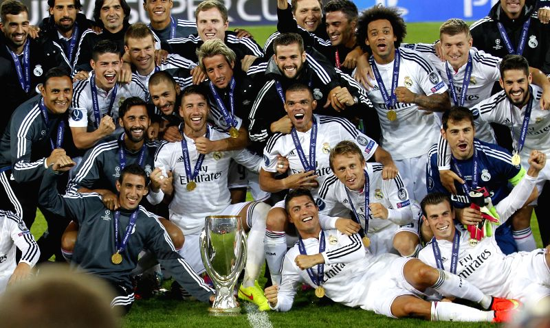 Real Madrid's players pose for photos with the trophy after the UEFA Super Cup match between Real Madrid and Sevilla at Cardiff City Stadium in Cardiff, Britain on .
