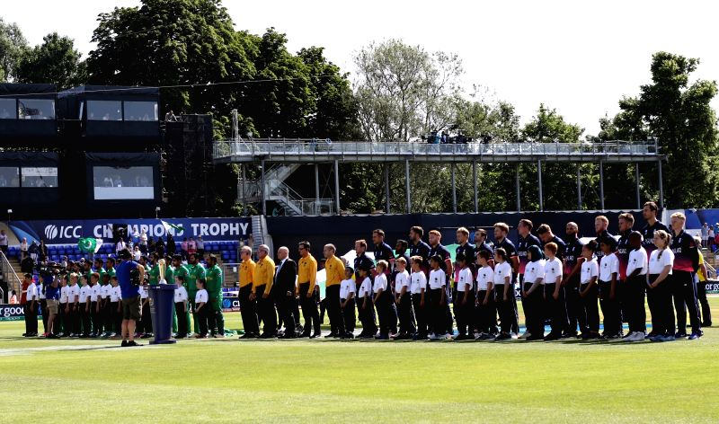 Cardiff: English as well as Pakistani cricketers stand for national anthem ahead of the first Semi-final match of ICC Champions Trophy between England and Pakistan at Sophia Gardens in ... - Surjeet Yadav