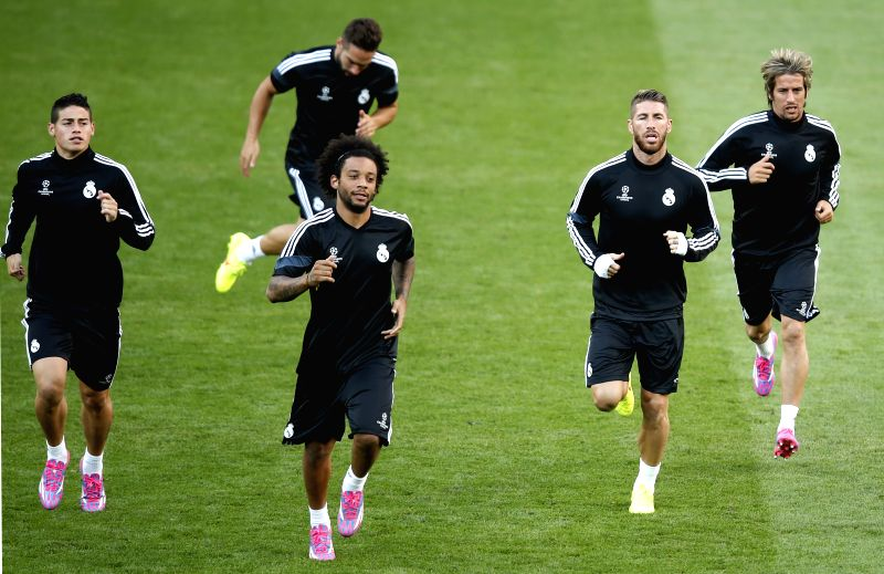 James Rodriguez, Marcelo, Ramos and Fabio Coentrao (front, from L to R) of Real Madrid take a training session for the UEFA Super Cup match between Real Madrid and ..