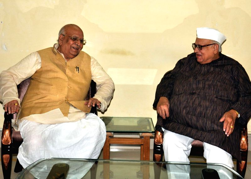 Caretaker Governor of Uttar Pradesh Aziz Qureshi during a meeting with BJP leader Lalji Tandon at his residence in Lucknow on July 1, 2014.