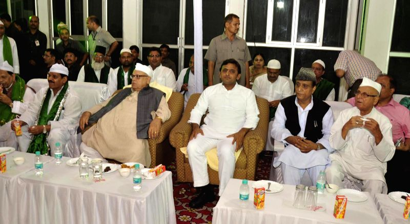 Caretaker Governor of Uttar Pradesh Aziz Qureshi with Uttar Pradesh Uttar Pradesh Chief Minister Akhilesh Yadav, Uttar Pradesh Cabinet Minister Mohd Azam Khan and others during an 'Iftar' party ... - Akhilesh Yadav, Mohd Azam Khan and Vinay Chandra Mishra