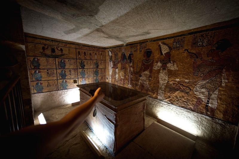 A visitor takes photo inside the facsimile of Tutankhamen Tomb, in Luxor, southern touristic city of Egypt, April 30, 2014. The newly opened touristic site on Thursday .