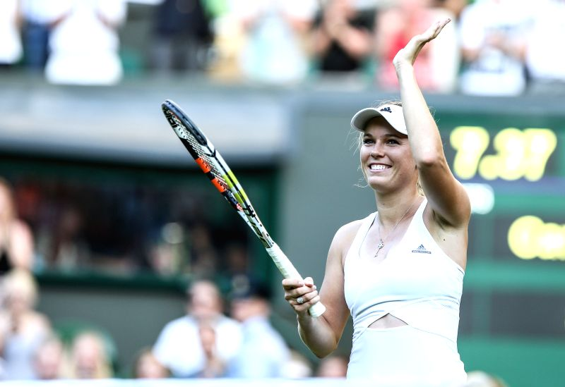 Caroline Wozniacki of Denmark greets the audience after beating Zheng Saisai of China during the women's singles first round match at 2015 Wimbledon Tennis ...