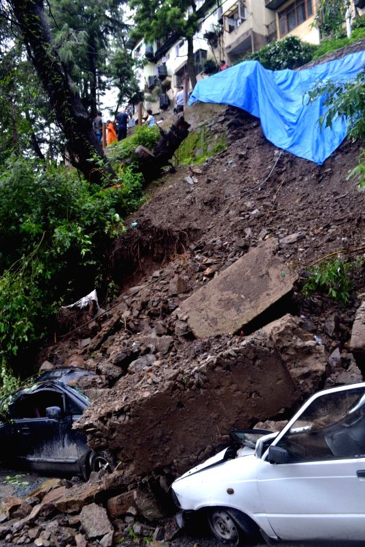 Cars buried under debris after a landslide struck Shimla on July 24, 2018.