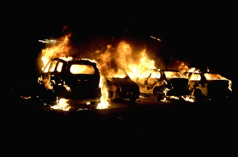 Cars torched during a clash between two groups in Bhopal on May 30, 2017.