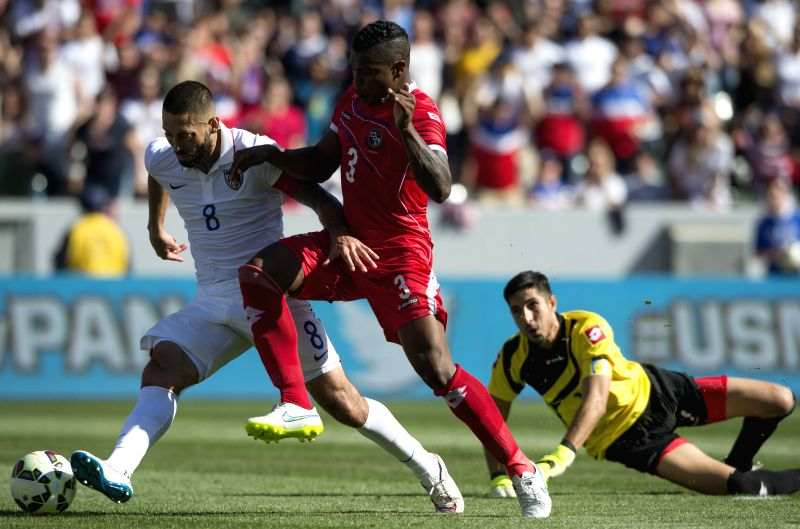 Clint Dempsey (L) of the United States shoots and scores during a soccer friendly match between the US and Panama in Carson City, the US, Feb. 8, 2015. The US ...