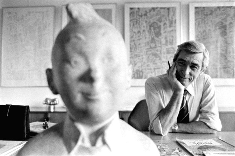 Cartoonist Herge with his famous creation