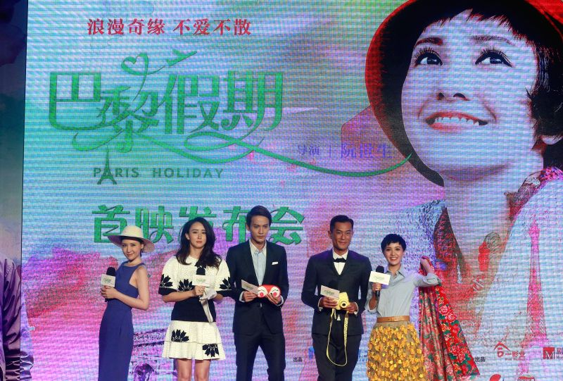 """Cast members Candy Liu, Hu Jing, Jeremy Jones, Louis Koo and Amber Kuo (from L to R) attend the premiere of """"Paris Holiday"""" in Beijing, capital of China, ..."""