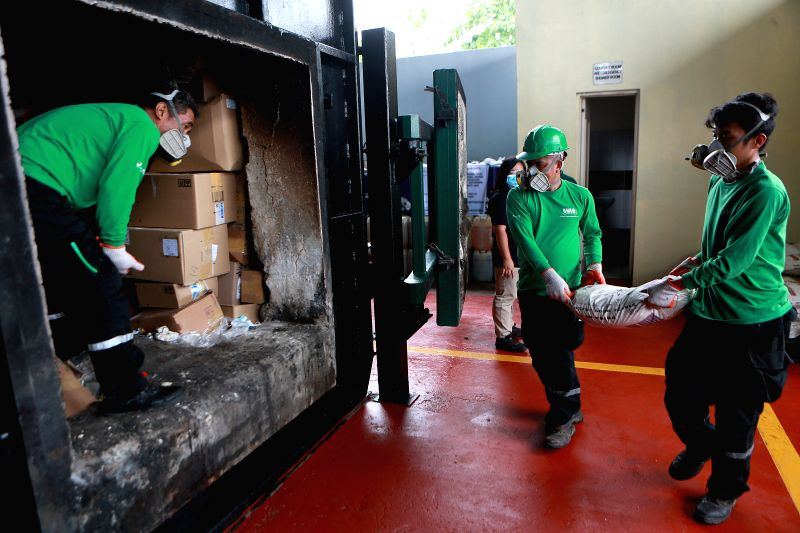 CAVITE, July 27, 2018 - Workers load confiscated illegal drugs into an incinerator during the destruction of illegal drugs in Cavite Province, the Philippines, July 27, 2018. The Philippine Drug ...