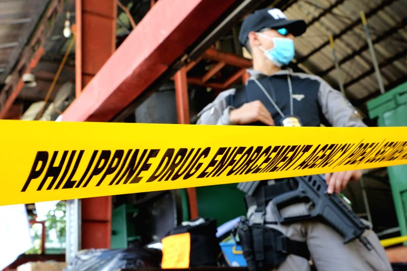 CAVITE PROVINCE, July 14, 2016 - A member of Philippine Drug Enforcement Agency (PDEA) guards the dangerous drugs during the destruction of confiscated illegal drugs in Cavite Province, the ...