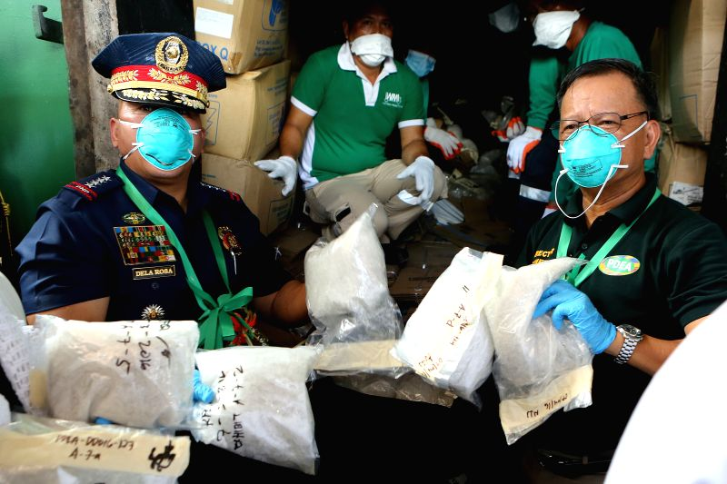 CAVITE PROVINCE, July 14, 2016 - Philippine Drug Enforcement Agency (PDEA) Director General Isidro Lapena (R) and Philippine National Police (PNP) Chief Ronald dela Rosa hold bags of methamphetamine ...
