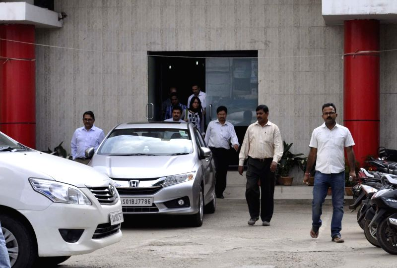 CBI officials come out of the office of Newslive channel after carrying out raids in Guwahati on Aug 28, 2014.