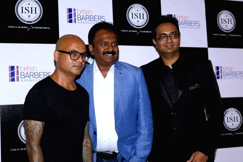 Celebrity hairstylist Aalim Hakim and Billionaire Barber Ramesh Babu during the India's first hair styling event dedicated to Men's grooming in Mumbai on April 17, 2017.