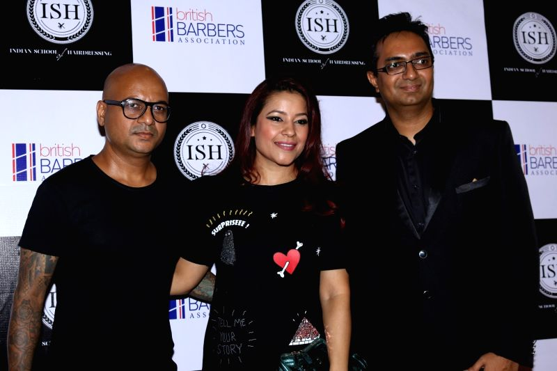 Celebrity hairstylist Aalim Hakim with his wife Shanoo and hair care innovator Ayaz Kabaniduring the India's first hair styling event dedicated to Men's grooming in Mumbai on April 17, 2017.