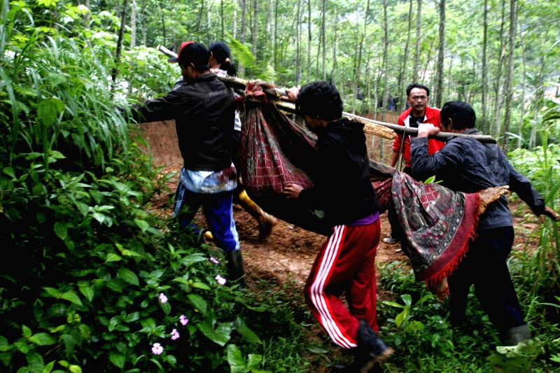 Rescuers evacuate victims of landslide in Banjarnegara district of Central Java, Indonesia, Dec. 13, 2014. Rescuers had found 19 corpses and suspended ...