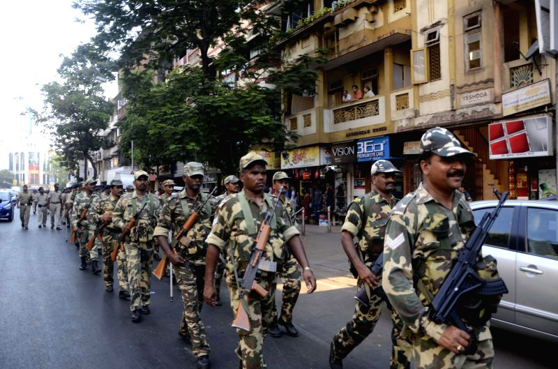 Central Reserve Police Force (CRPF) and Mumbai Police personnel conduct a flag march ahead of the 6th phase of 2014 Lok Sabha Elections in Mumbai on April 22, 2014.