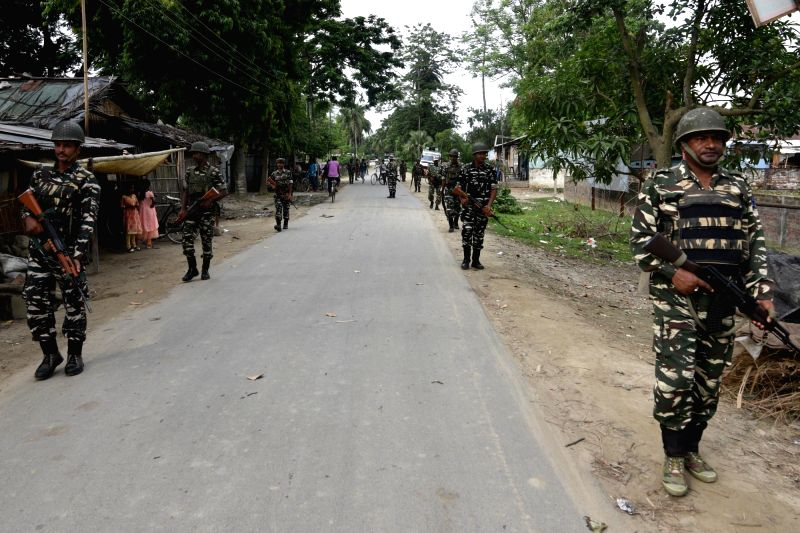 Central Reserve Police Force (CRPF) personnel patrol a street ahead of the declaration of Draft National Register of Citizens (NRC) in Assam; in Nagaon on July 28, 2018. The Draft NRC is ...
