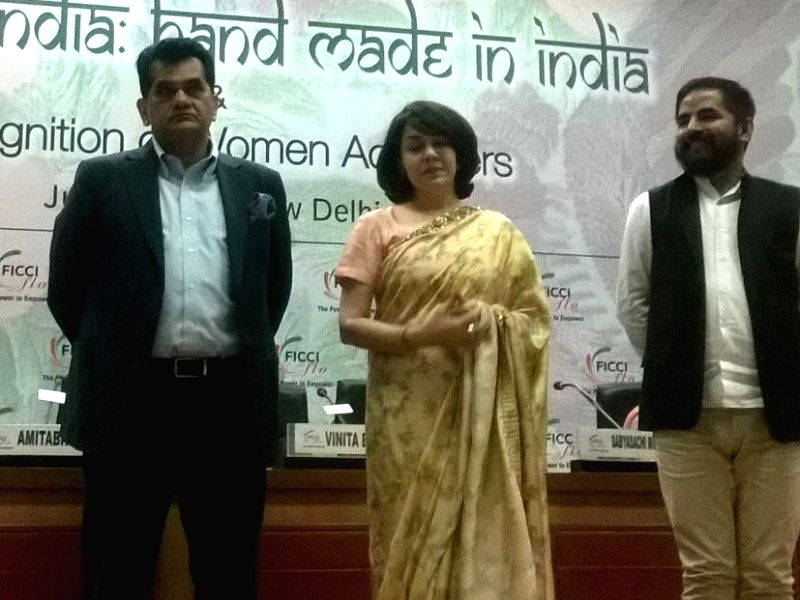 CEO NITI Aayog Amitabh Kant, FLO President Vinita Bimbhet and fashion designer Sabayasachi during a FICCI Ladies Organisation (FLO) meeting on 'Make in India: Hand Made in India' in New ...