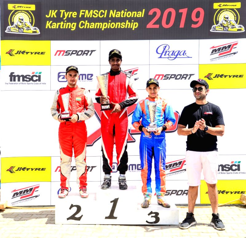 Chaggalagatti: Gold medal winner Nirmal Umashankar (C) with silver medalist Debarun Banerjee (L) and bronze medalist Shahan Ali Mohsin (R) after winning gold medal in Senior category during FMSCI National Karting Championship at the podium at the Mec