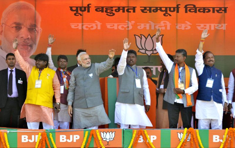 Prime Minister Narendra Modi waves at the public during a rally ahead of assembly polls in Chaibasa of Jharkhand's West Singhbhum on Nov 25, 2014.