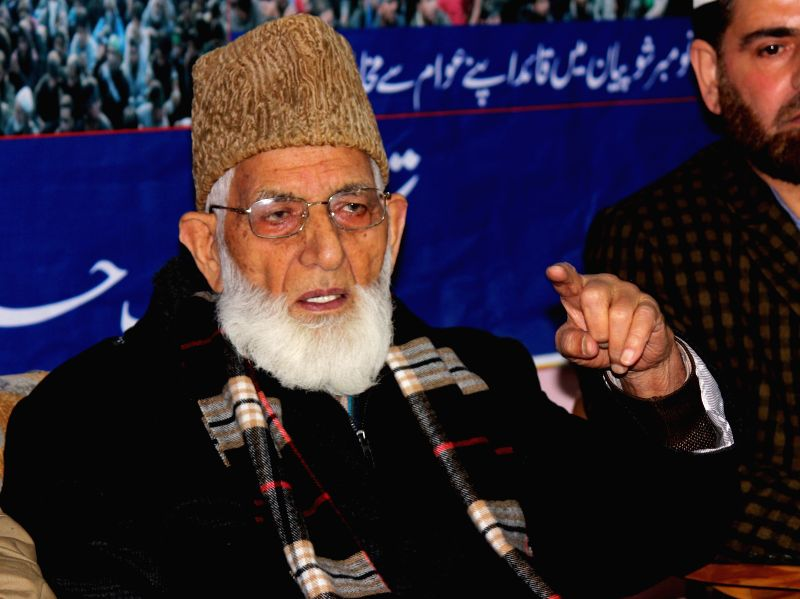 Chairman All Parties Hurriyat Conference, Syed Ali Geelani addresses a press conference in Srinagar on April 18, 2014.