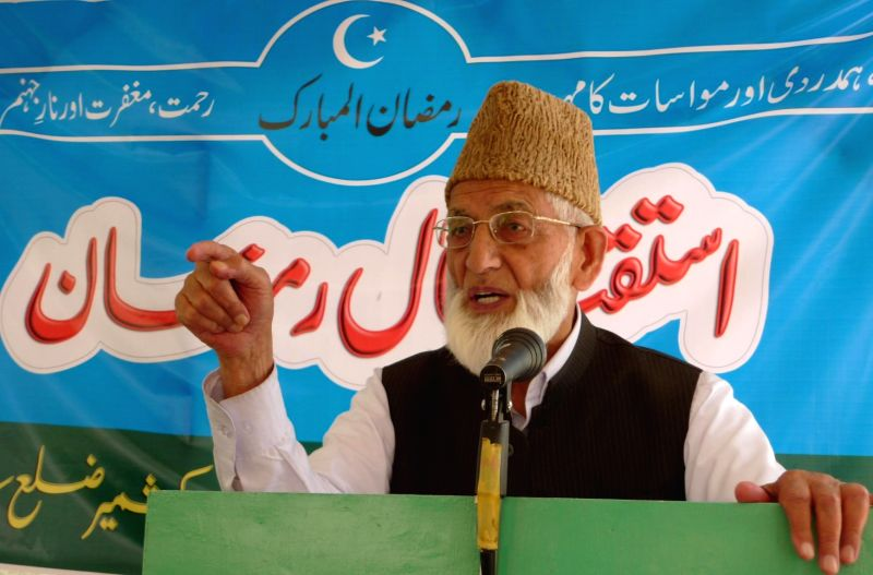Chairman All Parties Hurriyat Conference, Syed Ali Geelani addresses a congregation organised to welcome Ramadan in Srinagar on June 29, 2014.