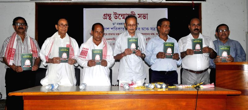 Chairman of Srimanta Sankardev Kalakshetra Prabhat Chandra Das and other dignitaries during release of Dr. Narakanta Adhikari's book 'Ekobingsho Satikat Sanardev aru Satra' in Guwahati on April 10, ..