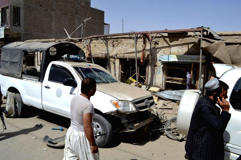 CHAMAN, Aug. 7 Pakistani policemen inspect a damaged police van at the bomb blast site in southwest Pakistan's Chaman on Aug. 7, 2014. Eleven people, including three policemen, were ...