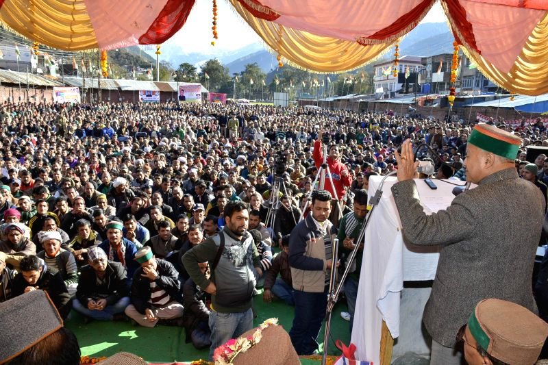 Himachal Pradesh Chief Minister Virbhadra Singh addresses a public rally in Chamba to redress public grievances and inaugurate development projects on Jan 15, 2015. - Virbhadra Singh