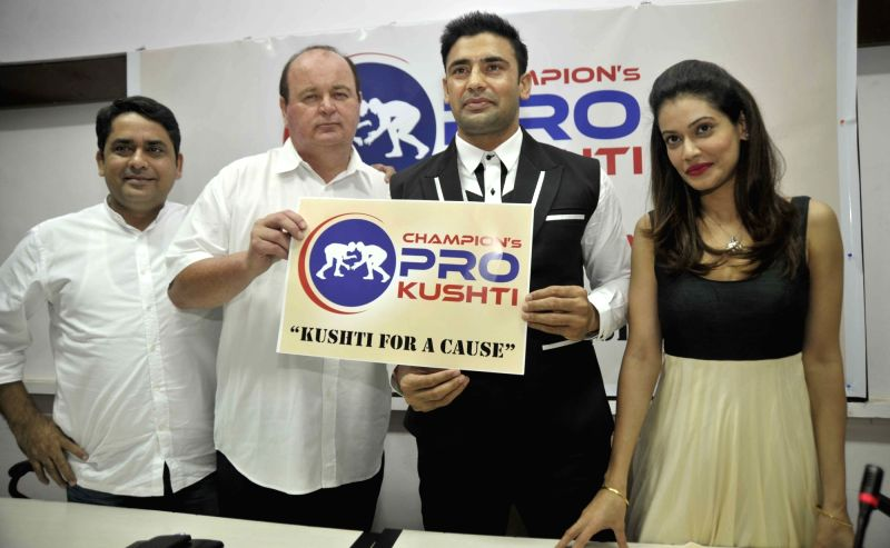 Champions Pro Kushti Co Founder Janardan Pandey, World Wrestling Professionals Director Mark Andrew Beale, International Wrestle Sangram U Singh, actress Payal Rohatgi during a programme ... - Payal Rohatgi and Janardan Pandey