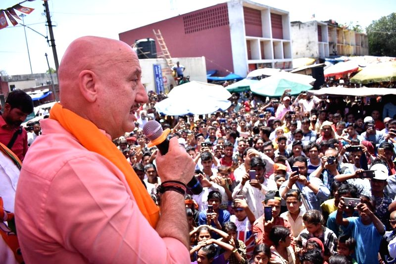 Actor Anupam Kher addresses at an election campaign in support of  his wife, BJP's candidate from Chandigarh, Kirron Kher for the forthcoming Lok Sabha polls, in Chandigarh