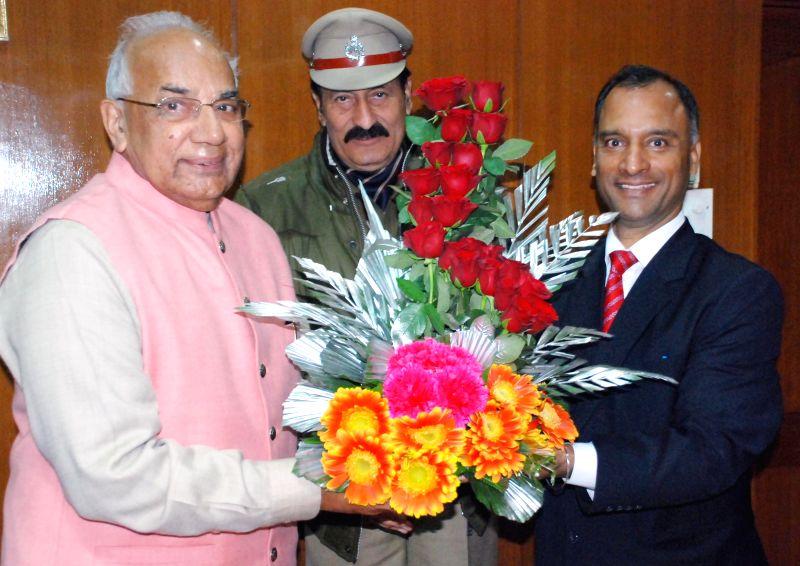 Advisor UT Chandigarh Vijay Kumar Dev calls on Haryana Governor Kaptan Singh Solanki at Haryana Raj Bhavan in Chandigarh on Jan. 12, 2015. - Kaptan Singh Solanki